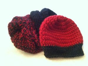 red and black crochet hats