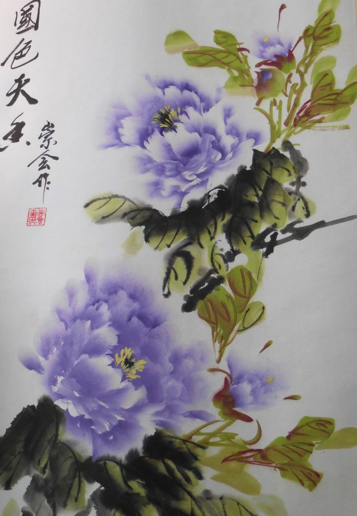 Two purple peonies