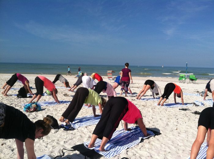 Downward Dog is easier on the beach.  The warm sand supports your heels.